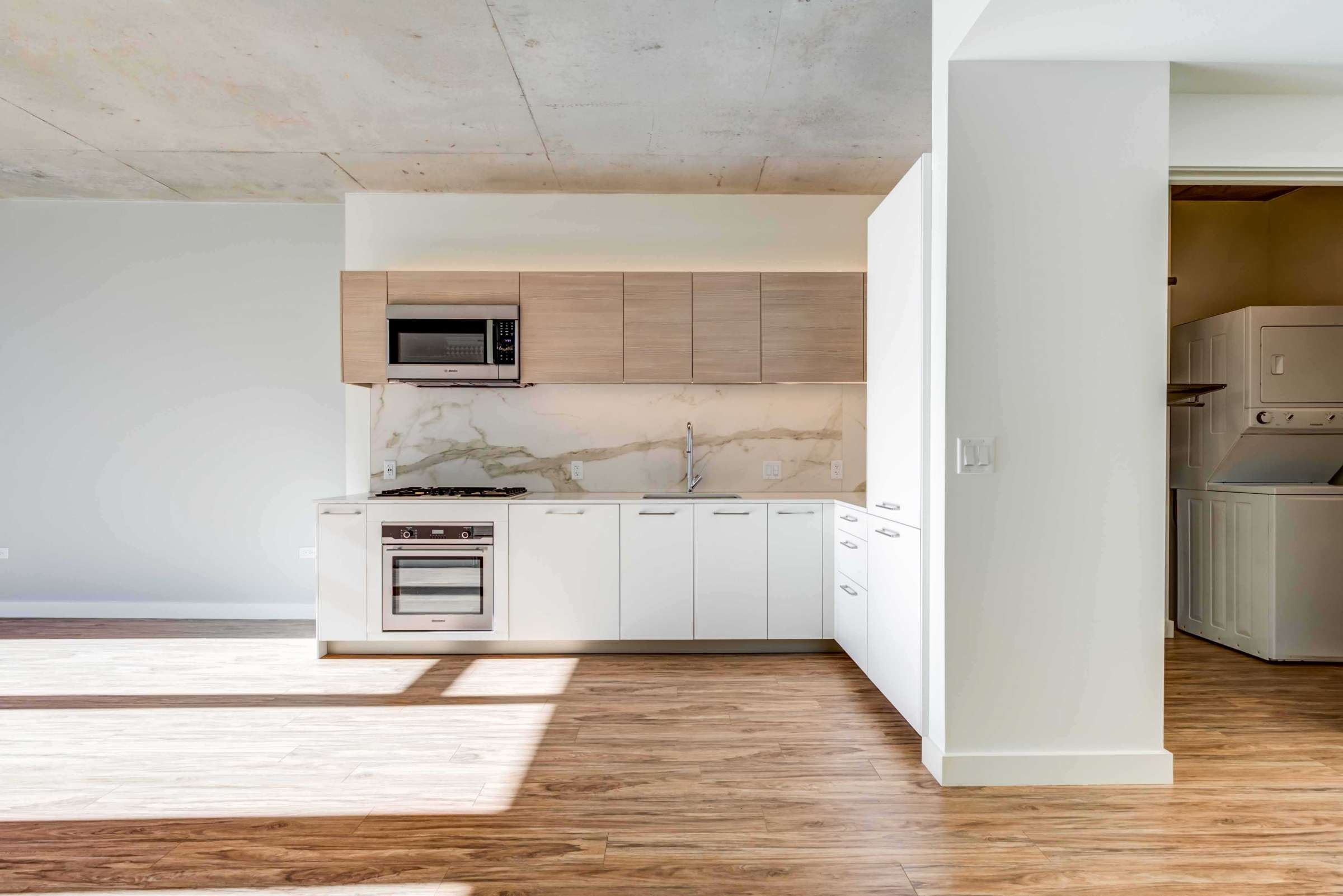 Luxury West Loop Apartments EMME - Modern Kitchen and In-Unit Washer and Dryer