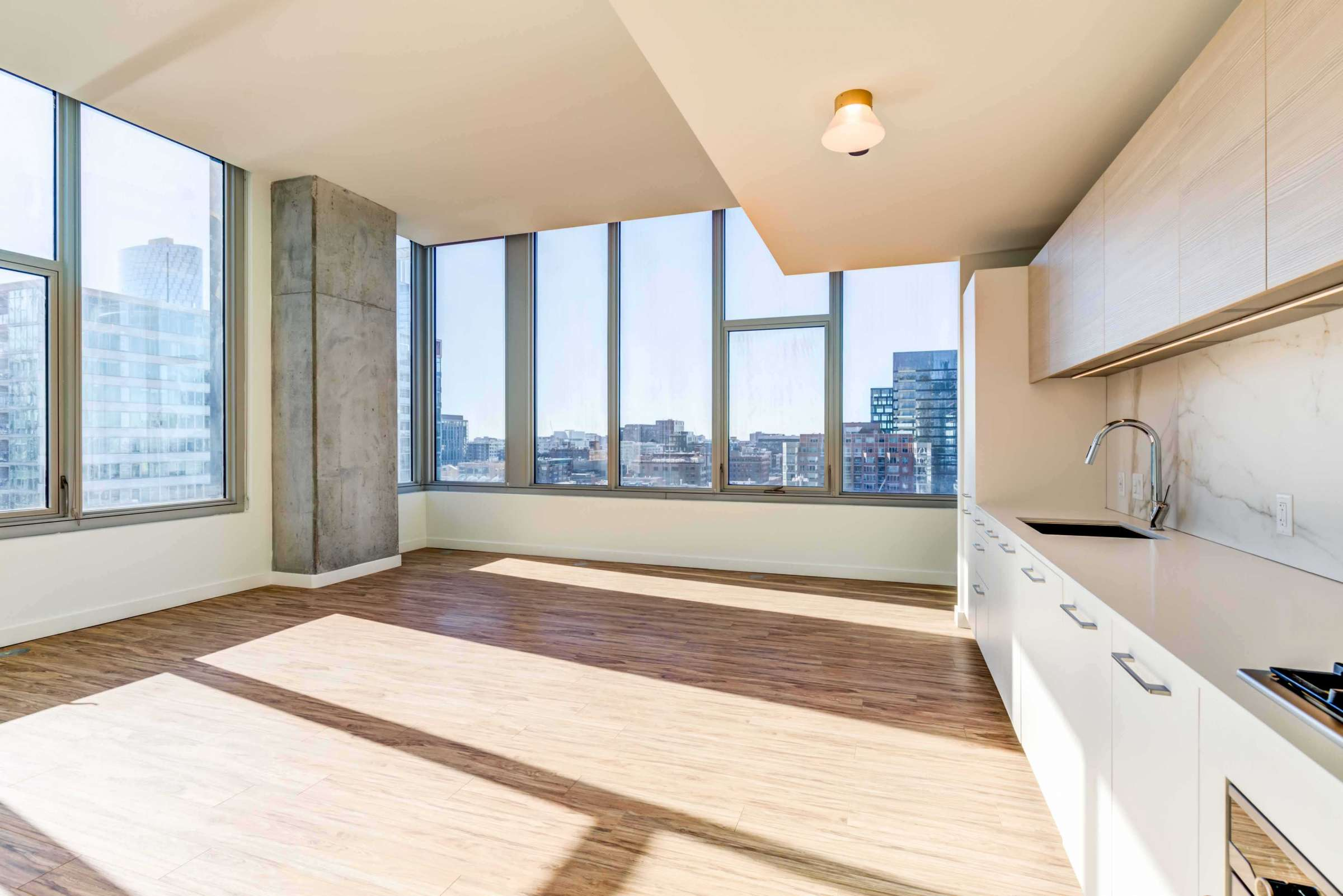 Luxury West Loop Apartments EMME - Large Windows With Views and Modern Kitchen
