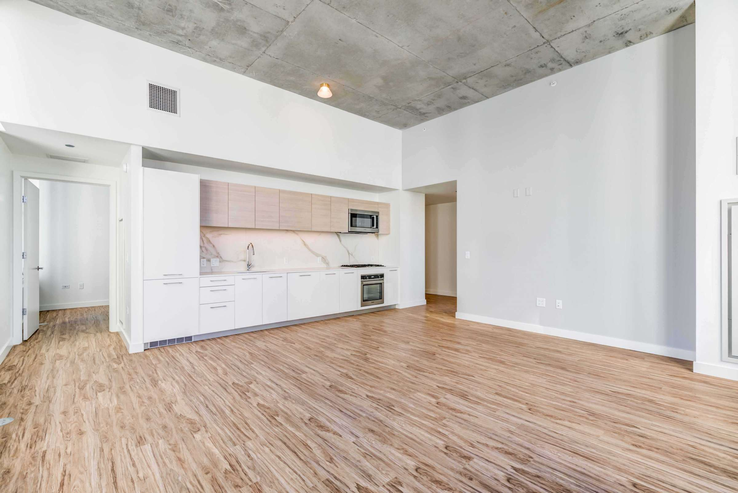 Luxury West Loop Apartments EMME - Spacious Living Room and Modern Kitchen