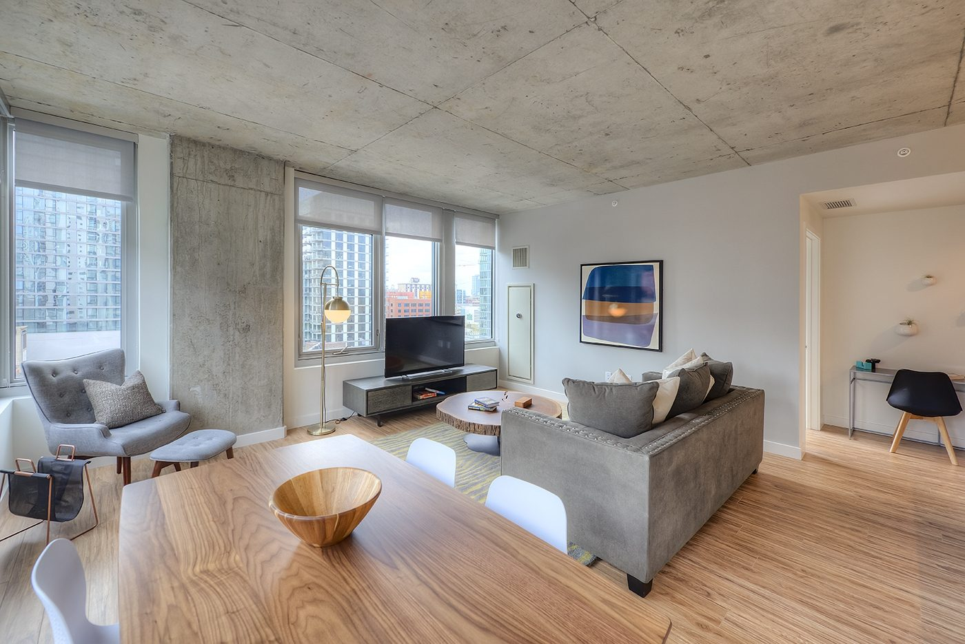 Luxury West Loop Apartments EMME - Spacious Living Room and At-Home Work Station